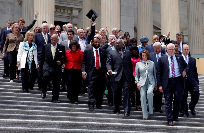 U.S. House Democrats walk out on the East Front on Capitol Hill in Washington, U.S., after their sit-in over gun-control law